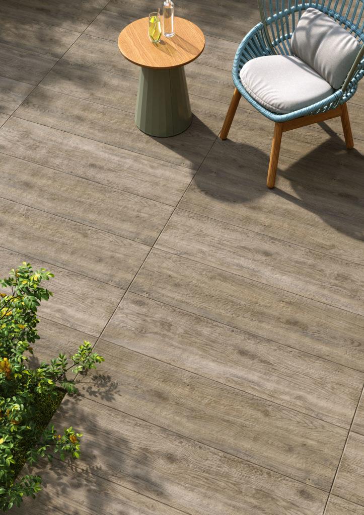 dettaglio di render di spazio outdoor con poltroncina su pavimento di ceramica