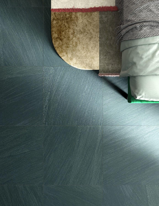 dettaglio di rendering di camera con pavimento in ceramica effetto pietra e arredi moderni