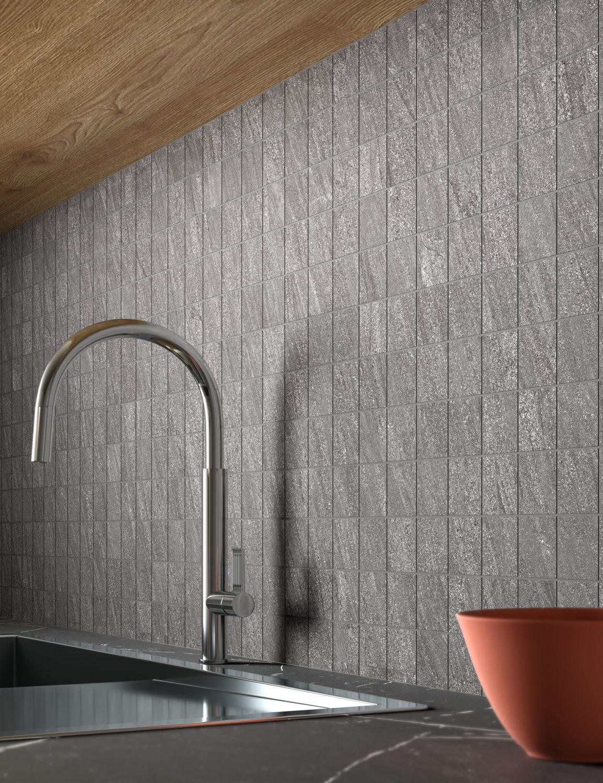 dettaglio di rendering di cucina con rivestimento in ceramica effetto pietra e arredi moderni