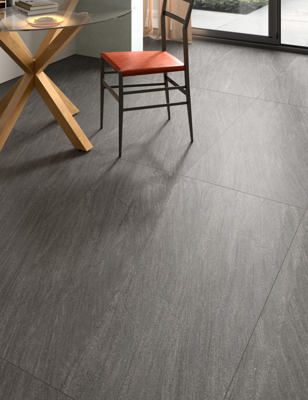 dettaglio di rendering di cucina con pavimento in ceramica effetto pietra e arredi moderni