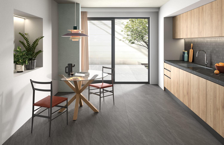 rendering di cucina con pavimento in ceramica effetto pietra e arredi moderni