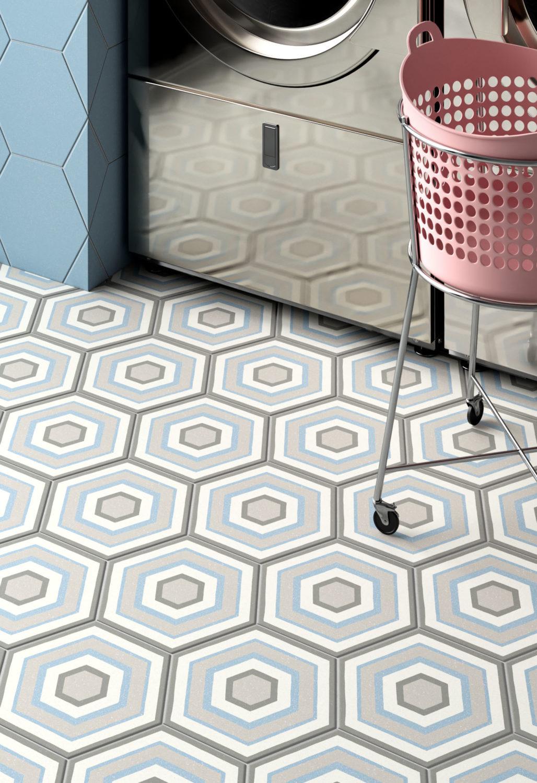 dettaglio di rendering di lavanderia a gettoni con pavimento di piastrelle esagonali decorative e cesto per la biancheria su ruote e lavatrice