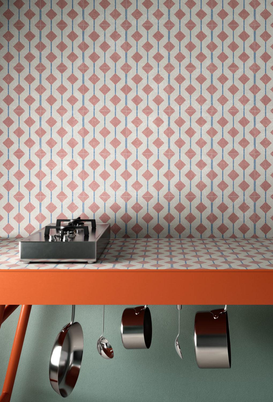 dettaglio di piano cucina con rivestimento murale di piastrelle
