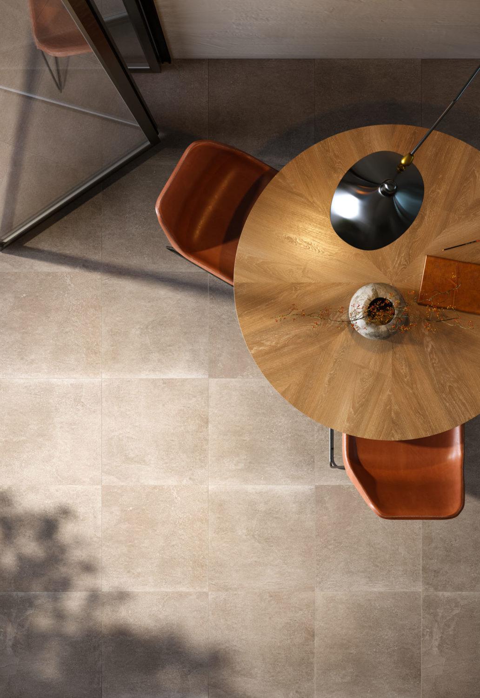 render di tavolo e sedie con pavimentazione in pietra visto dall'alto