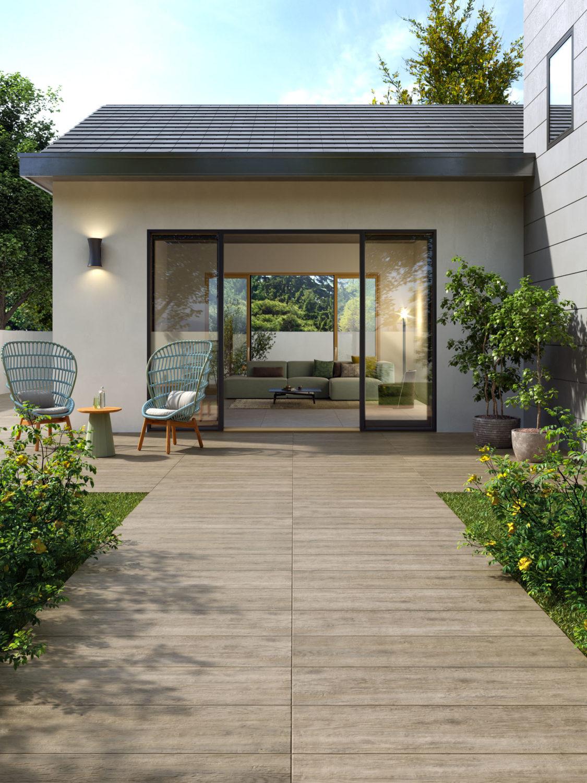 render di spazio outdoor con pavimentazione di ceramica n primo piano e salotto sullo sfondo