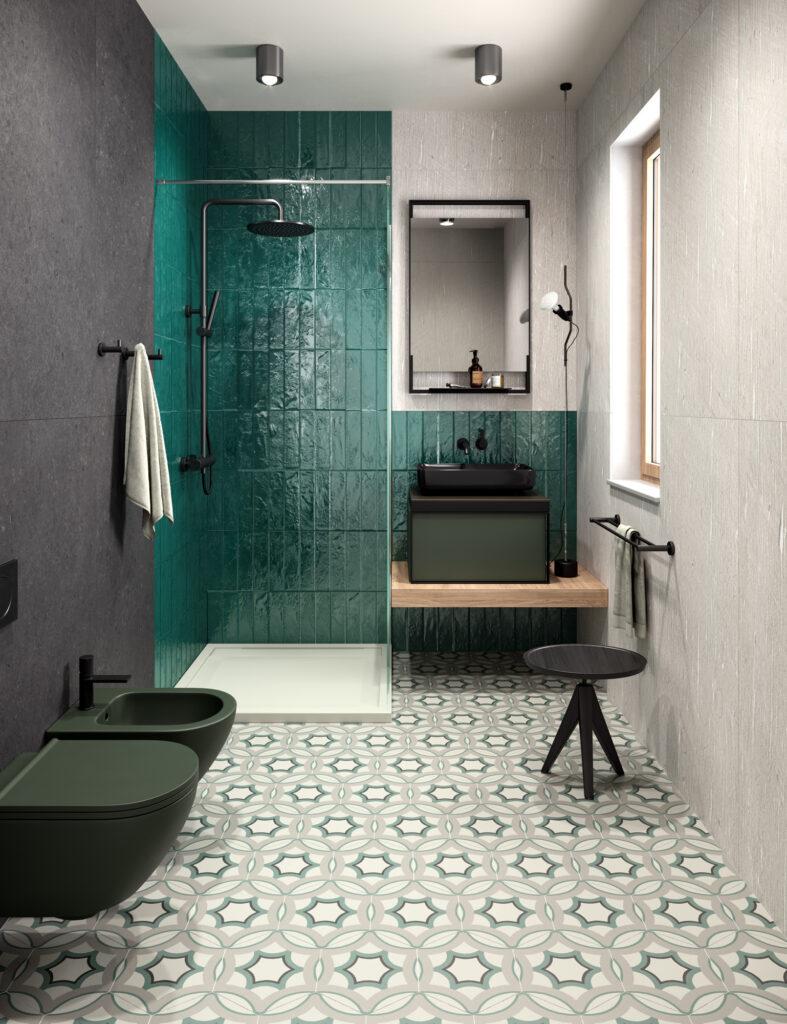 render di bagno con rivestimenti in ceramica lucidi color smeraldo e piastrelle con decorazioni geometriche