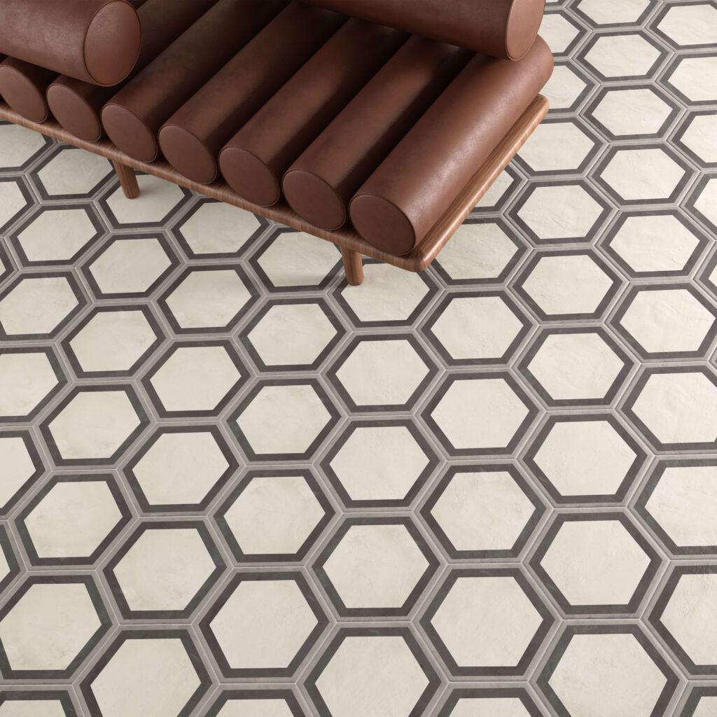 rendering con dettaglio di pavimento di esagone colore chiaro in ceramica e divano in pelle