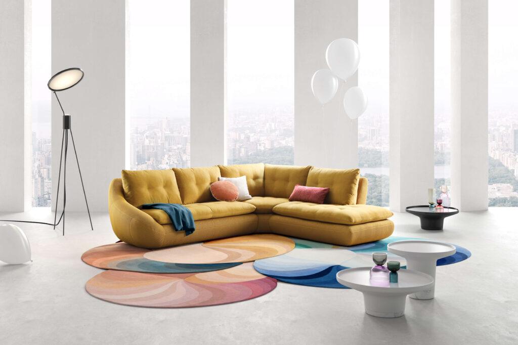 rendering di soggiorno minimal con fotoinserimento 3d di divano