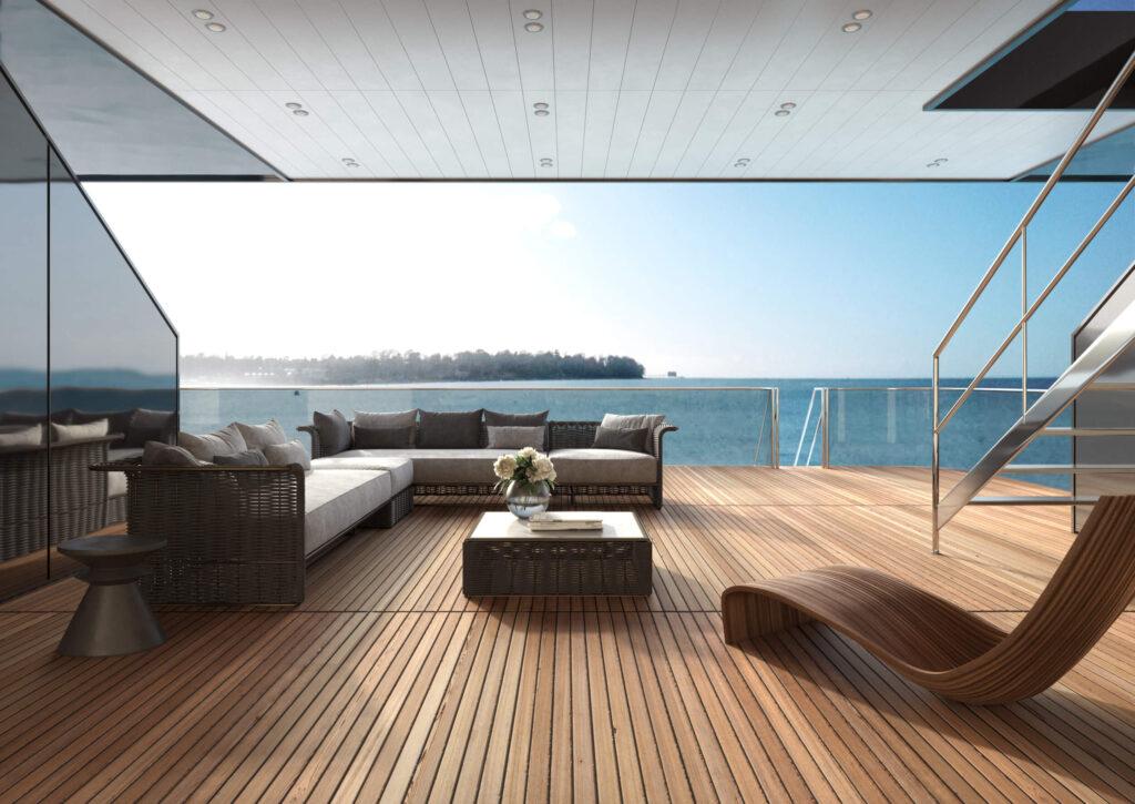 rendering dell'interno di uno yacht con vista sul ponte di poppa arredato con divanetti in rattan e chaise longue